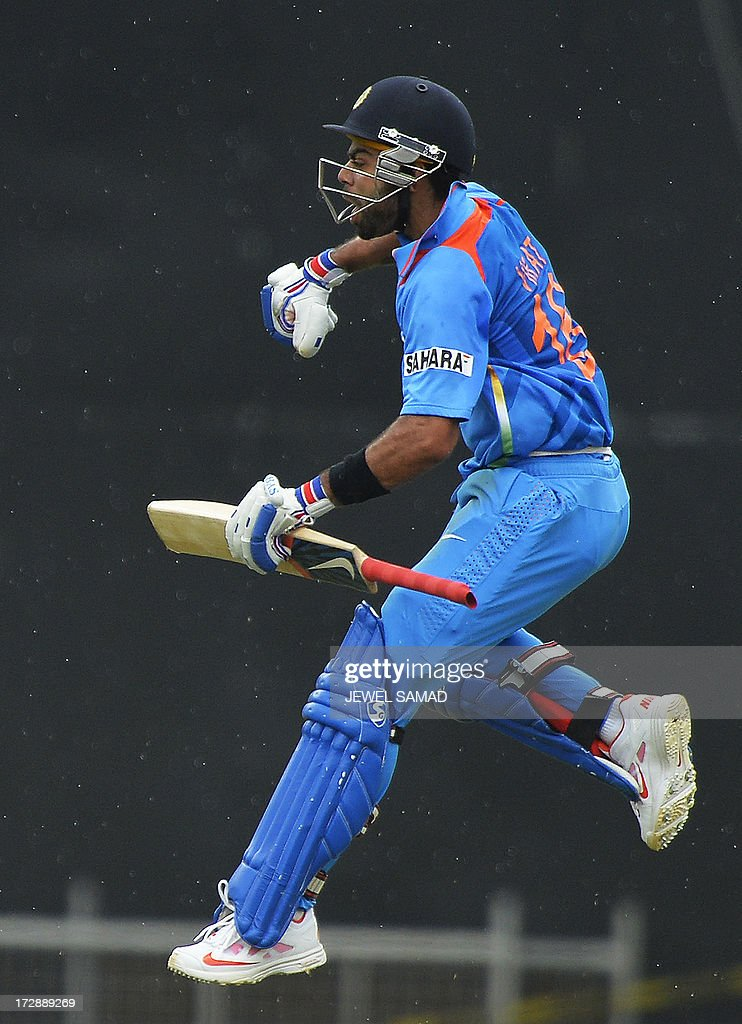 Indian cricket team captain Virat Kohli leaps in the air as he celebrates scoring his century during the fourth match of the Tri-Nation series between India and West Indies at the Queen's Park Oval in Port of Spain on July 5, 2013. India have scored 311/7 at the end of their innings. AFP PHOTO/Jewel Samad