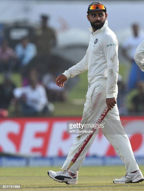 Indian cricket team captain Virat Kohli leaves the pitch after the fourth day of the first Test match between Sri Lanka and India at Galle...