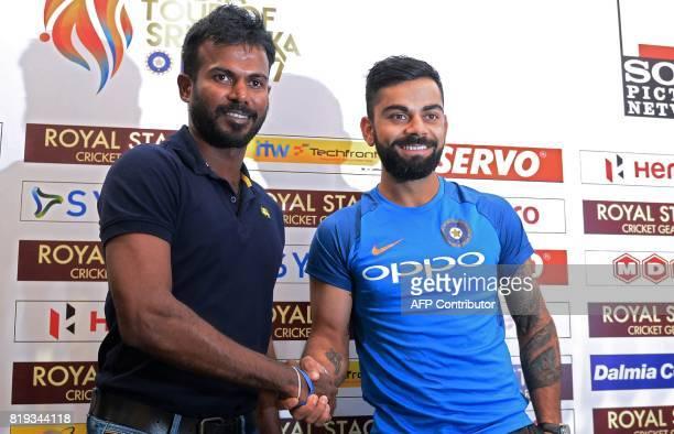 Indian cricket team captain Virat Kohli shakes hands with Sri Lankan oneday international and Twenty20 captain Upul Tharanga during a press...