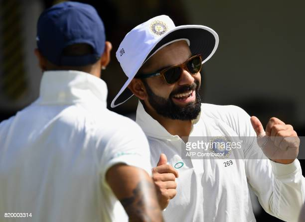 Indian cricket team captain Virat Kohli shares a light moment with teammates during the first day of the twoday warmup match between Sri Lanka Board...