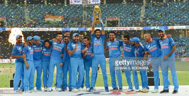 Indian Cricket team celebrates after won during the final one day international Asia Cup cricket match between Bangladesh and India at the Dubai...