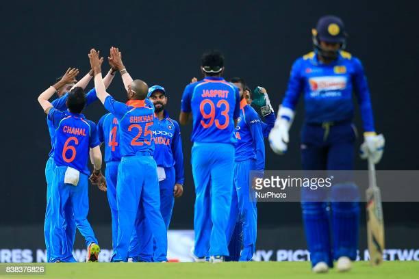 Indian cricket team celebrates as Sri Lankan cricket captain Upul Tharanga walks back following his dismissal during the 2nd One Day International...