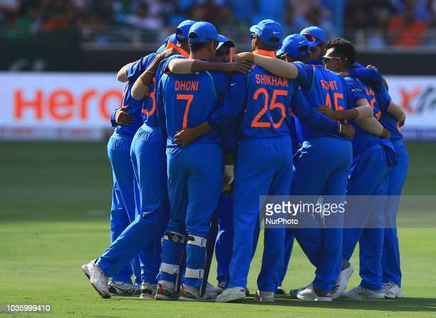 Indian cricket team discuss as they walk in to the playing are during the 5th cricket match of Asia Cup 2018 between India and Pakistan at Dubai...
