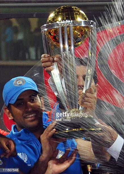 Indian Cricket Team Mahendra Singh Dhoni poses with the trophy after victory in the Cricket World Cup 2011 final over Sri Lanka at The Wankhede...