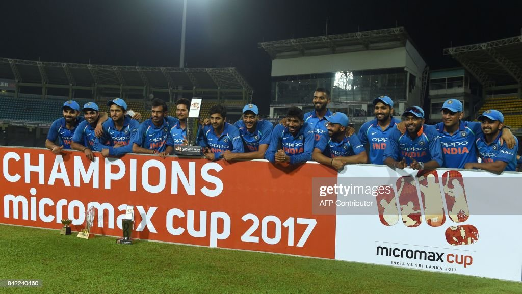 Indian cricket team players pose with the trophy after their win over Sri Lanka in the fifth and last one-day international cricket match between Sri Lanka and India at The R. Premadasa Stadium in Colombo on September 3, 2017. India beat Sri Lanka by six wickets, and win the one day series 5-0. /
