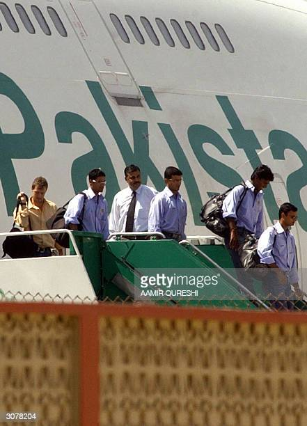 Indian cricket team players unboard a plane at their arrival in the Karachi International Airport 12 March 2004 as part of India's first full Test...