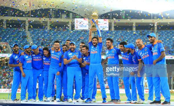 Indian cricket team pose with the Asia Cup 2018 after defeating Bangladesh in the final at Dubai International cricket stadiumDubai United Arab...