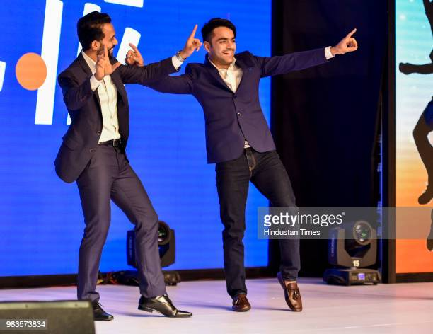 Indian cricketer Ajinkya Rahane and Afghan cricketer Rashid Khan perform dance step during CEAT Cricket Rating Awards function on May 28 2018 in...