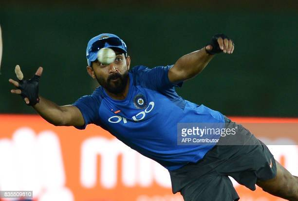 Indian cricketer Ajinkya Rahane catches a ball during a practice session at the Rangiri Dambulla International Cricket Stadium in Dambulla on August...