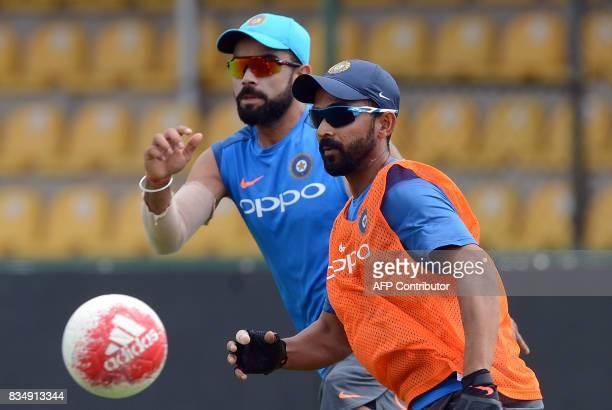 Indian cricketer Ajinkya Rahane plays football with captain Virat Kohli during a practice session at the Rangiri Dambulla International Cricket...