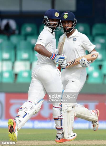 Indian cricketer Ajinkya Rahane teammate Cheteshwar Pujara run between the wickets during the first day of the second Test match between Sri Lanka...
