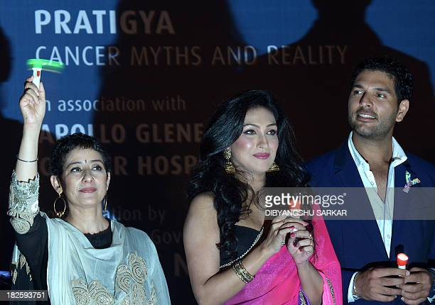 Indian cricketer and cancer survivor Yuvraj Singh poses with Bollywood actress and fellow cancer survivor Manisha Koirala and Bollywood actress...