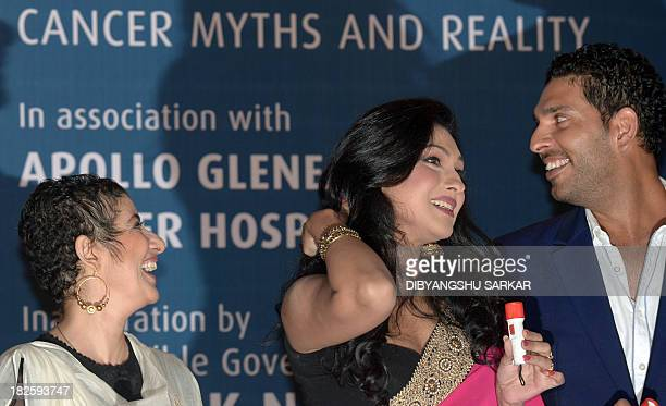 Indian cricketer and cancer survivor Yuvraj Singh shares a light moment with Bollywood actress and fellow cancer survivor Manisha Koirala and...