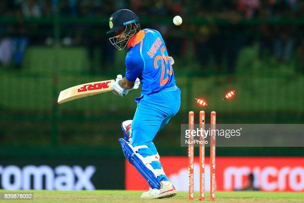 Indian cricketer and opening batsman Shikhar Dhawan is bowled out during the 3rd One Day International cricket match between Sri Lanka and India at...