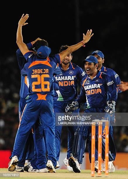 Indian cricketer Ashish Nehra and teammates celebrate the dismissal of unseen Sri Lankan cricket captain Kumar Sangakkara during the final One Day...