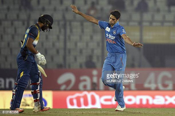Indian cricketer Ashish Nehra reacts after the dismissal of the Sri Lanka cricketer Dinesh Chandimal during the Asia Cup T20 cricket tournament match...