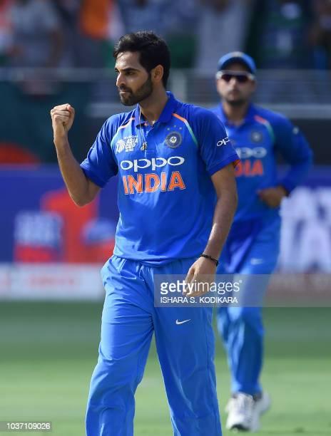 Indian cricketer Bhuvneshwar Kumar celebrates after he dismissed Bangladesh batsman Liton Das during the one day international Asia Cup cricket match...