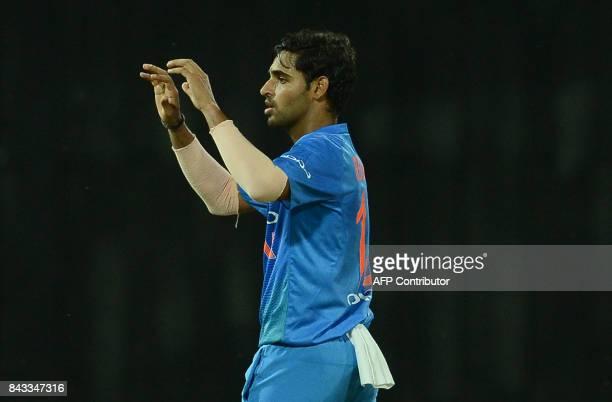 Indian cricketer Bhuvneshwar Kumar celebrates after he dismissed Sri Lankan cricketer Upul Tharanga during the Twenty20 international cricket match...