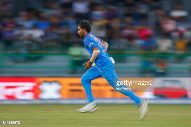 Indian cricketer Bhuvneshwar Kumar delivers a ball during the 5th and final One Day International cricket match between Sri Lanka and India at the R...