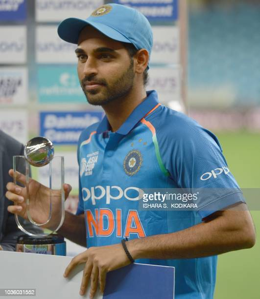 Indian cricketer Bhuvneshwar Kumar poses with the 'Player of the Match' trophy after the one day international Asia Cup cricket match between...