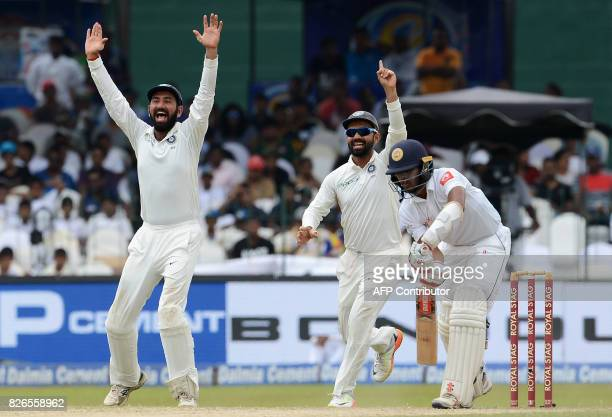 Indian cricketer Cheteshwar Pujara and Lokesh Rahul unsuccessfully appeals for a Leg Before Wicket decision against Sri Lankan cricketer Kusal Mendis...