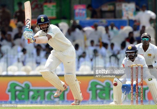Indian cricketer Cheteshwar Pujara plays a shot during the first day of the second Test match between Sri Lanka and India at the Sinhalease Sports...
