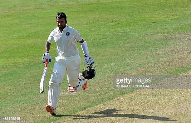 Indian cricketer Cheteshwar Pujara runs between the wickets during the first day of the threeday warmup match between Sri Lanka Board President's XI...