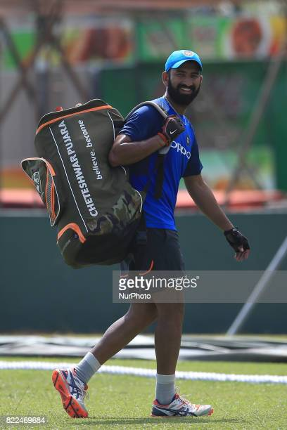 Indian cricketer Cheteshwar Pujara walks away after taking part in a practice session ahead of the 1st test match between Sri Lanka and India at...