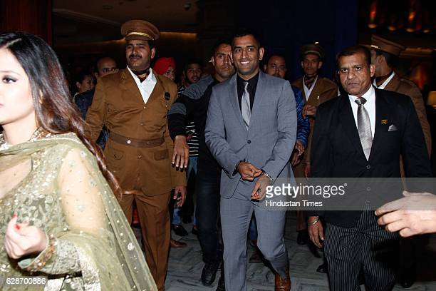 Indian Cricketer MS Dhoni during the wedding reception of Indian Cricketer Yuvraj Singh and Bollywood actor Hazel Keech at ITC Maurya on December 7...