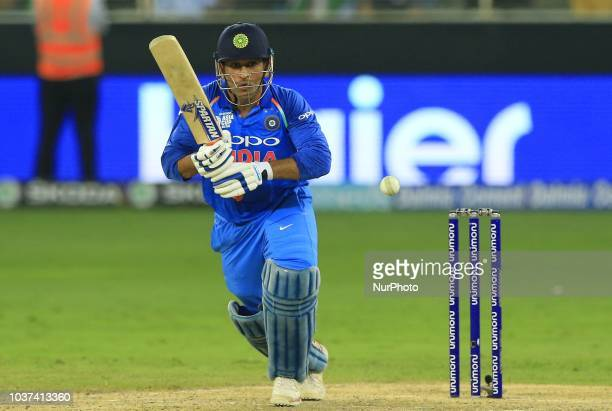 Indian cricketer MS Dhoni plays a shot during the 1st cricket match of the Super four group of Asia Cup 2018 between India and Bangaldesh at Dubai...