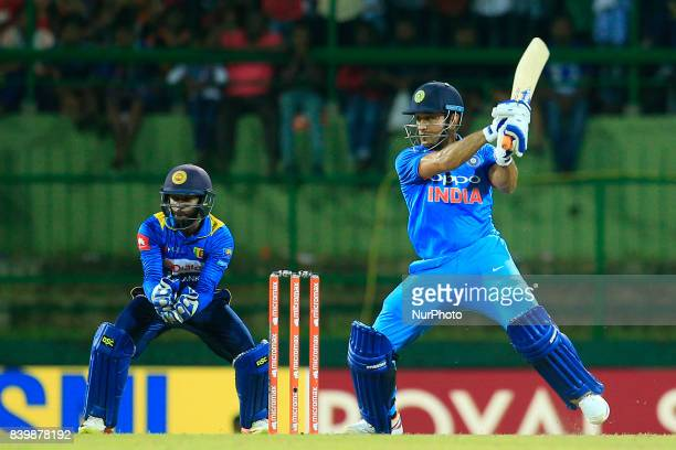 Indian cricketer MS Dhoni plays a shot during the 3rd One Day International cricket match between Sri Lanka and India at the Pallekele international...