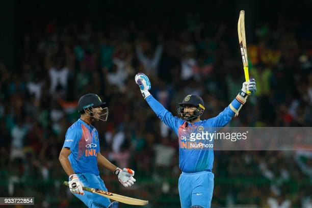 Indian cricketer Diensh Karthik celebrates after hitting the winning run during the final Twenty20 cricket match of NIDAHAS Trophy between Bangladesh...