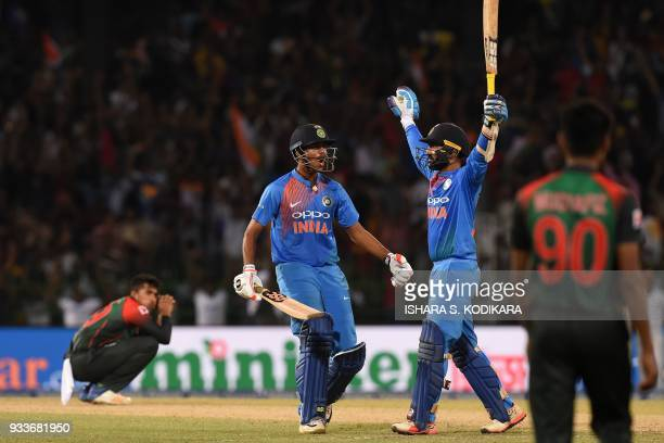 Indian cricketer Dinesh Karthik and Washington Sundar react after scoring the winning run to defeat Bangladesh by 4 wickets during the final Nidahas...