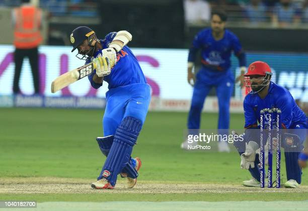 Indian cricketer Dinesh Karthik plays a shot during the Asia Cup 2018 cricket match between India and Afghanistan at Dubai International cricket...