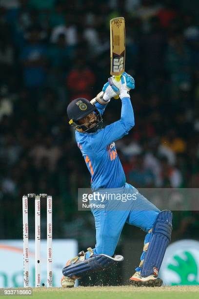 Indian cricketer Dinesh Karthik plays a shot during the final Twenty20 cricket match of NIDAHAS Trophy between Bangladesh and India at R Premadasa...