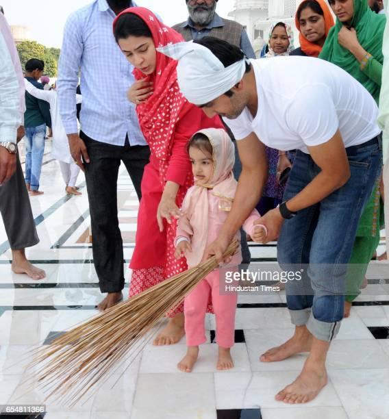 Indian Cricketer Gautam Gambhir along with his daughter and wife Natasha Jain Gambhir performing sewa at Golden Temple on March 18 2017 in Amritsar...