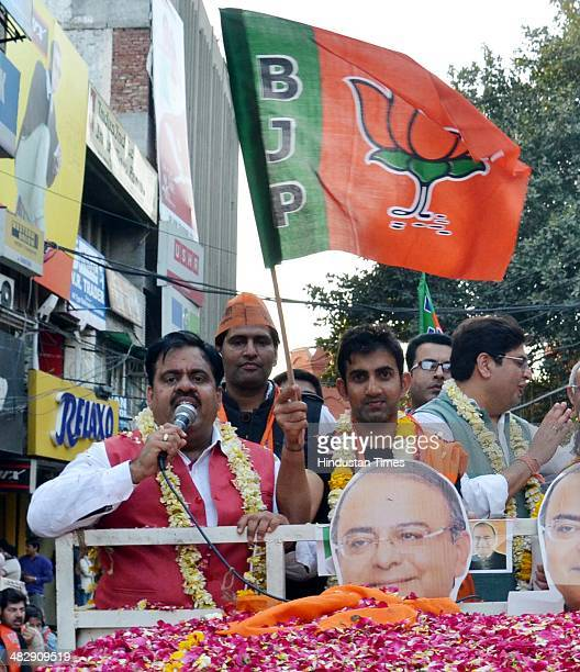 Indian cricketer Gautam Gambhir along with Kamal Sharma BJP State President during an election campaign road show in favour of Arun Jaitley BJP Lok...