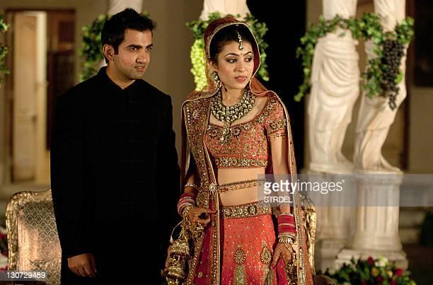 Indian cricketer Gautam Gambhir and his bride Natasha Jain pose during their marriage ceremony in New Delhi late October 28 2011 Gambhir and Jain...