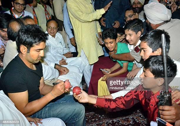 Indian cricketer Gautam Gambhir giving autographes to budding players alongwith BJP Lok Sabha Candidate from Amritsar Arun Jaitley during an election...