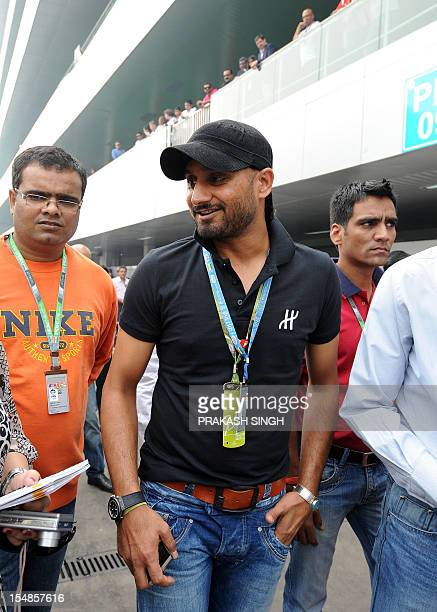 Indian cricketer Harbhajan Singh arrives in the paddock prior to The Formula One Indian Grand Prix 2012 at The Buddh International circuit in Greater...