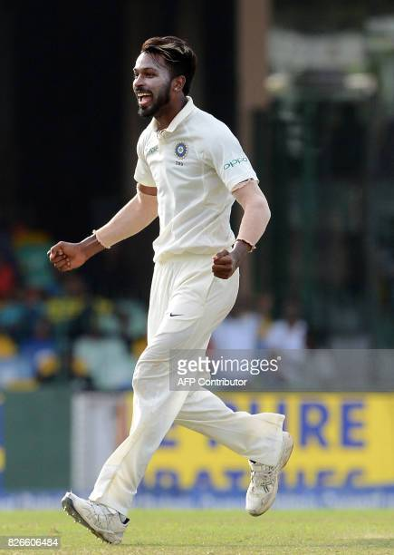 Indian cricketer Hardik Pandya celebrates after he dismissed Sri Lankan cricketer Kusal Mendis during the third day of the second Test match between...
