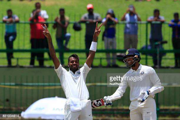 Indian cricketer Hardik Pandya celebrates after scoring 100 runs during the 2nd Day's play in the 3rd Test match between Sri Lanka and India at the...