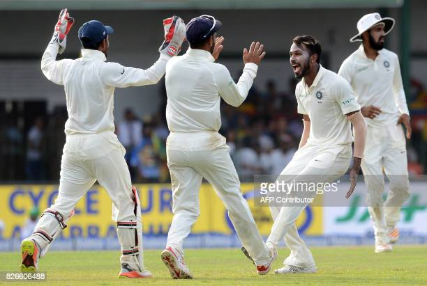 Indian cricketer Hardik Pandya celebrates with his teammates after he dismissed Sri Lankan cricketer Kusal Mendis during the third day of the second...