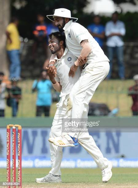 Indian cricketer Hardik Pandya celebrates with teammate Lokesh Rahul after dismissing Sri Lankan cricketer Niroshan Dickwella during the fourth day...