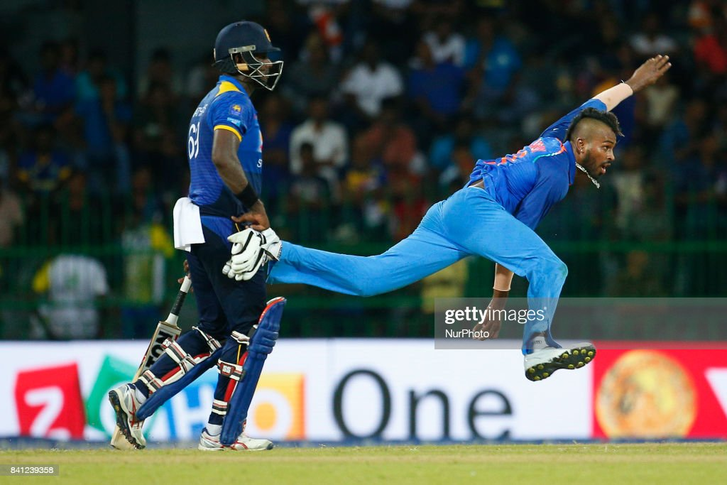 Indian cricketer Hardik Pandya (R) delivers a ball as Sri Lankan batsman Angelo Mathews looks on during the 4th One Day International cricket match between Sri Lanka and India at the R Premadasa international cricket stadium at Colombo, Sri Lanka on Thursday 31 August 2017.