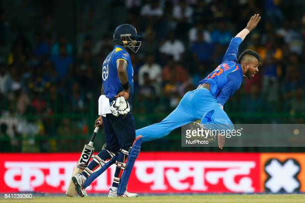 Indian cricketer Hardik Pandya delivers a ball as Sri Lankan batsman Angelo Mathews looks on during the 4th One Day International cricket match...