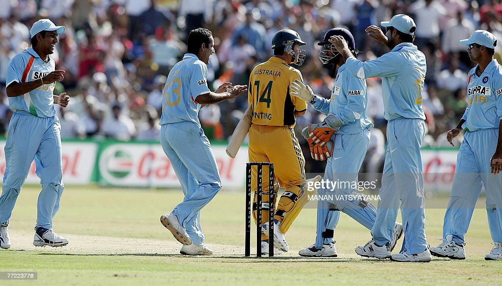Indian cricketer Irfan Pathan celebrates with temmates after taking the wicket of Australian captain Ricky Ponting during the fourth OneDay...