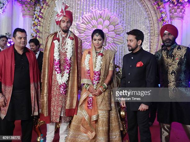 Indian Cricketer Ishant Sharma and Basketball player Pratima Singh with Amit Sharma BCCI President Anurag Thakur and Sarandeep Singh during their...