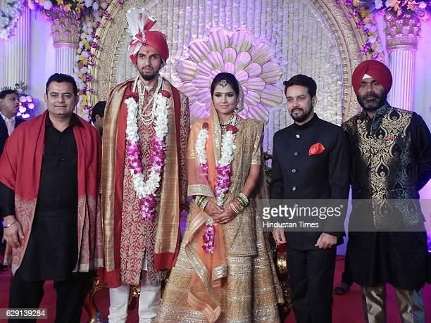 Indian Cricketer Ishant Sharma and Basketball player Pratima Singh with Amit Sharma BCCI President Anurag Thakur and Sarandeep Singh during their...