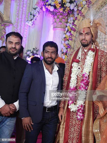 Indian Cricketer Ishant Sharma and Indian wrestler Yogeshwar Dutt during his wedding reception on December 9 in New Delhi India